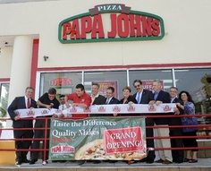 John Schnatter, red shirt, Founder, Chairman and CEO of Papa John's International, Inc., cuts the ribbon for the opening of his 4000th restaurant on Friday Sept. 14, 2012, in New Hyde Park, N.Y. l-r: Nassau County Executive Edward Mangano (red tie), Executive Vice President of Papa John's Anthony Thompson, New Hyde Park franchise owner Peter Mehta, John Schnatter, Town of North Hempstead Supervisor Jon Kaimen, NY Assemblyman Ed Ra, Town of North Hempstead Town Clerk Leslie Gross, President…