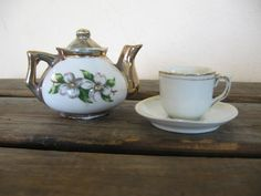 Tiny gold Teapot w/ matching teeny Cup and Saucer by TheReUpShoppe,