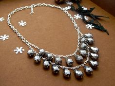 Glistening tear drop silver beads are hand fastened and meticulously arranged, capturing the shimmer of fresh fallen snow!    Necklace measures 18