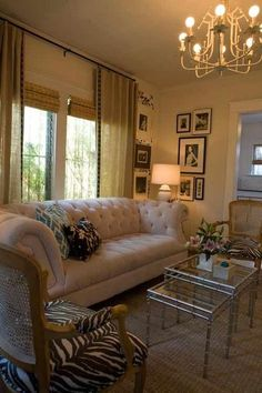 Traditional meets Hollywood Regency in this Venice Beach cottage. The Chesterfield sofa, with all its pomp and circumstance, makes a stylish statement, yet still provides a pair of zebra printed bergere chairs room to shine.