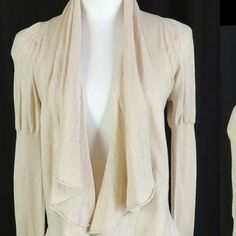 Beige ruffle cardigan This cardigan is lightweight and has an adorable ruffle feature that continues from the fly away front to the back. This could be a great addition to anyones spring wardrobe. I've never worn it but it doesn't have the tag on it. Only little plastic piece the tag has ripped off :/ The Limited Sweaters Cardigans