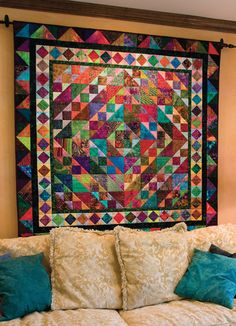 Vivid triangles: Best Wall Quilts from McCall's Quilting. I finally found the pattern for this. I'll be making this soon.