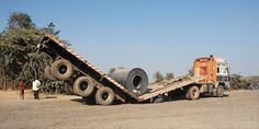 A lorry collapses under a heavy load in Kutch, India.    C Patel from Birmingham.