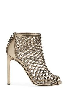 Feeling stylish in these gold caged open toe booties.