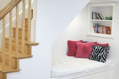 McLean basement renovation by BOWA features children's reading nook under the stairs.