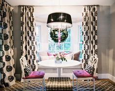 Dining Room Traditional Photo - A mix of patterns in a breakfast nook with a white tulip-style table and a window seat