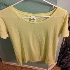 PINK by VS lightweight tee size small! never worn!! this tee is super soft and light. it is a pale yellow color. originally purchased from PINK for $29.50! PINK Victoria's Secret Tops Tees - Short Sleeve