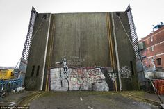 Banksy...The artwork was painted on an old drawbridge in Hull. Locals said they first spotted the w...