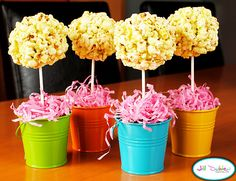 Popcorn balls made with marshmallows...would be cute for place cards at a kid's party.