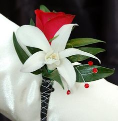 red sweetheart rose and white orchid boutonniere