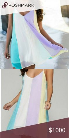 Just In!!! Sexy Summer Dress! Great ready for sun and fun!! This color block dress is so adorable and perfect for a summer night out or day at the beach!! Hues of white, yellow, blue, and purple in a  color block design! This dress is lined, has a v-neck and spaghetti straps! Dresses Mini