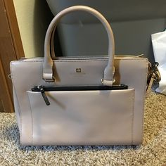 """Kate Spade Bag Kate Spade New York Large Bernadine Satchel Leather Front has gold embossed Kate Spade logo smooth taupe beige and black leather with pebbled leather trim on sides,   zip-top closure; front zip and slip pockets In front, keys easy access  flat bottom; 1 interior features zip and 2 slip multi-function pockets inside. 13""""W x 10"""" H x 5"""" D double handles; adjustable shoulder strap.Used Once. kate spade Bags Crossbody Bags"""