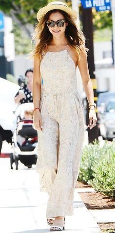 JUNE 30, 2014 Jamie Chung Jamie Chung stepped out over the weekend in a pretty pale floral print wide-leg jumpsuit, styling it with a straw Panama hat, a white cross-body purse, ankle-strap sandals, and tortoiseshell sunnies.