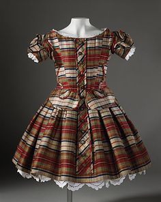 A wonderful boy's plaid dress dating to 1864.
