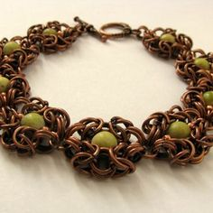 byzantine flower bracelet - I like the IDEA of chain maille jewelry, but it's all awfully... larpy? this may be my solution...