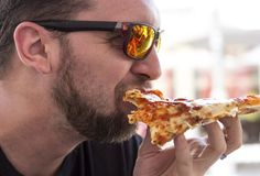 How You Eat Pizza Says a Lot About Your Personality