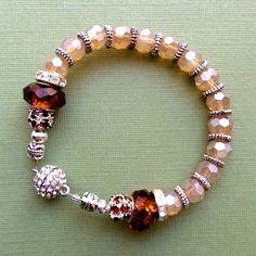 $14.00.  Gorgeous Honey and Topaz Bracelet by my very favorite vendor.  Love.