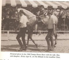 Billy and Kay Cox leading their daughter, Kristy at the 1968 Tampa Charity Horse Show.