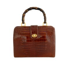Gucci Cognac Alligator Bag with Bamboo Handle | From a collection of rare vintage handbags and purses at http://www.1stdibs.com/fashion/accessories/handbags-purses/