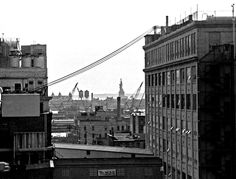 Daily life in the old Jersey City. Abandoned century factories on the Morris Canal, crane graveyards, the Statue of Liberty and Ellis Island (itself closed and decrepit) from the roof of an empty warehouse near the Colgate plant. Jersey City, New Jersey, City Journal, Ellis Island, Local History, Abandoned Places, Vintage Advertisements, San Francisco Skyline, Statue Of Liberty