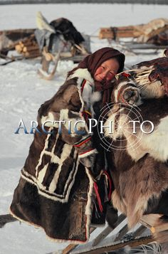 Nenets girl in traditional reindeer skin clothes in varied colours. Yamal. Siberia. Russia.: Russia, Yamal: Arctic & Antarctic photographs, pictures & images from Bryan & Cherry Alexander Photography.
