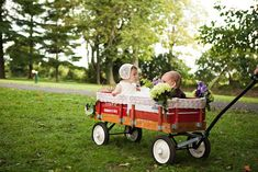 ADORABLE 'here comes the bride' wagon for the flower girl and page boy at this rustic chic wedding http://su.pr/1aN7tZ photo by Honey Heart Photo