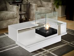 Level Compact | Decorpro The contemporary coffee table. A modern, chic design with ample space for storing books and magazines as well as snacks and coffee cups! Comes with an elegant, glass-encased tabletop fireburner.
