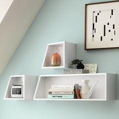SAIC tork shelves | CB2 - These aren't cut at an angle like I had hoped. They're square but one side just dips back toward the mountpoint.