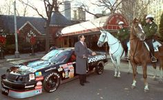 While celebrating his Championship season in New York City, Dale Earnhardt chats with NYPD mounted police outside of Tavern on the Green restaurant in Central Park, after winning the 1990 Winston Cup title