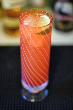 Malibu Bay Breeze - 1 1/2 oz Malibu coconut rum, 2 oz cranberry juice, 2 oz pineapple juice, garnish with a lime wedge and a dusting of freshly ground nutmeg. Serve in highball glass. ABV 6%.