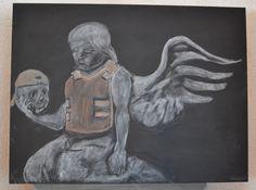 Banksy mit Kreide auf Tafel