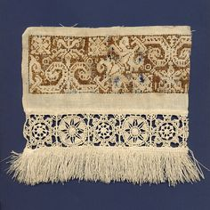 """Embroidered cutwork fragment, Italian, early 17th century, KSUM 1995.17.767 b.  The embroidery on this piece is an example of """"blackwork,"""" a form of counted thread embroidery. The original black color has oxidized to its current shade of brown."""