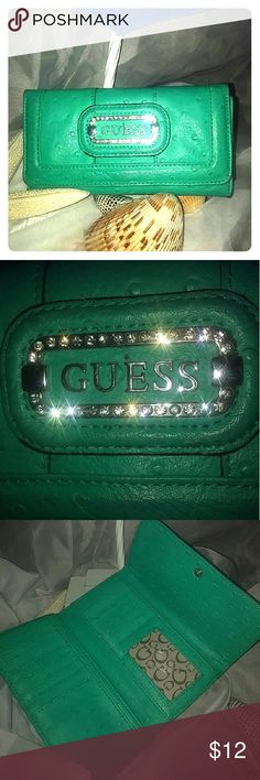 Guess wallet Beautiful leather guess wallet its gently used with a spot on back and zipper on back .look on last picture. The zipper works great just the pull tab is broken Guess Bags Wallets