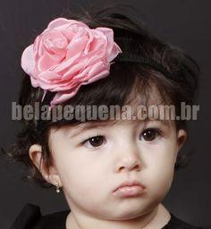 Roupa infantil marrom e rosa