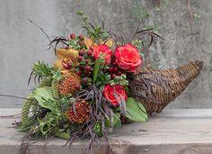 The classic cornucopia design with Protea!  http://shop.rogersgardens.com/browse.cfm/floral-arrangements/2,72.html?_ga=1.218399897.1480954403.1432337028