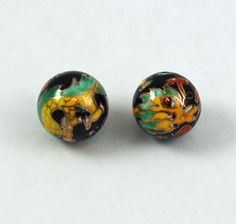 Vintage porcelain black dragon beads from Estatebeads.com