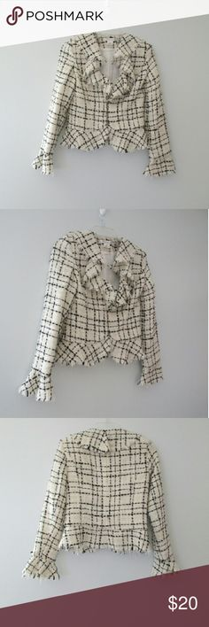 """White House Black Market Ruffled Peplum Blazer White House Black Market white and black chanel-like plaid jacket with a ruffled, unfinished hem trim. Blazer is fully lined, closes with hooks. Fabric is 100% acrylic. Very good condition with no flaws or signs of wear. Size 2. Measurements: shoulder to shoulder 15"""", sleeve length 20"""" with another 3"""" in ruffled trim, bust 36"""" and shoulder to bottom 21"""". White House Black Market Jackets & Coats Blazers"""