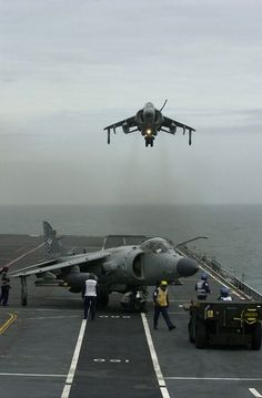 "British Aerospace Sea Harrier FA.2. ""A Royal Navy BAe Sea Harrier FA2 hovers above the flight deck of the flight deck of HMS Illustrious (R06) as it positions itself for landing on 25 June 2001. The aircraft belonging to 801 Naval Air Squadron was providing air support to British and U.S. units ashore during their participation in the Joint Maritime Course (JMC), the equivalent of the U.S. Navy's JTFEX with the USS Enterprise Carrier Battle Group."