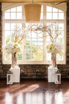 Rachel A. Clingen Wedding and Event Design, Branches create an archway with lovely white flower arrangements to the sides with lanterns