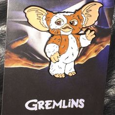 """Gizmo 1.5"""" enamel pin. Double posts and rubber clasps. Up for order now.  Link in profile or http://ift.tt/1NdhZIy  #GhastlyCommodities #pin #pins #enamelpin #horror #movie #halloween #monster #limitededition #pingame #punk #metal #gremlin #gremlins #gizmo #80s #90s #mogwai by ghastlycat"""