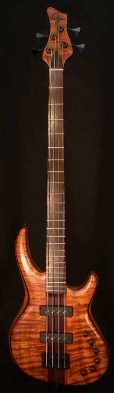 Flamed Koa 4-String Bass. RESEARCH #DdO:) - https://www.pinterest.com/DianaDeeOsborne/basses-of-life/ - BASSes OF LIFE - From the headstock we can see this lovely stringed instrument is from Wyn Guitars with luthiers based in Woodland Hills, California. No Treble reports that this is a  one- man custom bass shop run by Randy Fullmer, a man with a healthy obsession for exotic woods as well as an artist at heart. Bass Musician Magazine featured him in January 2011. Photo pinned via Scott…