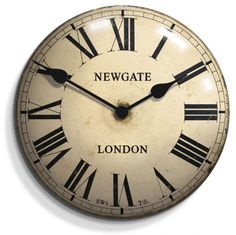 This traditional Newgate Chelsea Clock in Antique Cream has the classic black Roman numerals and wrap around metal hands.  The convex tin clock has a vintage style dial.