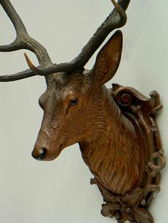 fine carved wood deer head ca. 1900 .... not fond of real animal heads staring at me from the wall....but would LOVE this one! the carving is wonderful!