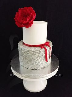 Scarlet and silver two-tiered round celebration cake.