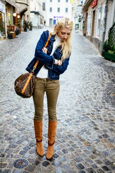 brown boots denim jacket skinny jeans and cozy sweater bmodish