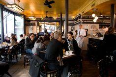 Cafe Charlot, Haut Marais, Paris.  White subway tile, dark grout, dark wood, gold and brushed chrome accents.