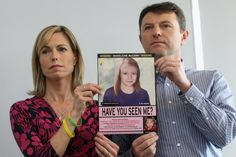 Kate and Gerry McCann hold an age-progressed police image of their daughter during a 2012 London press conference.