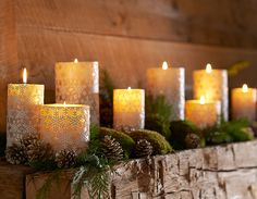 Mossy rocks and pinecones mixed with candles | Christmas Styles | Pottery Barn