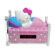 """Hello Kitty Sleeping Kitty Alarm Clock Radio with Night Light. Features * AM/FM Radio * 0.6"""""""" Red LED Display * Wake to Radio or Buzzer * Large, Easy to Locate Snooze Button * Sleep Function * Two Bedposts Light Up for Night Light (On/Off Switch)Power: * 120V~60Hz 7W * Battery Back-Up for Clock * 1 x 9V (not included)"""
