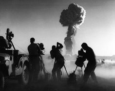 Government filmmakers document an atomic bomb explosion at the test site in Nevada. A Jeep has been equipped with a movie camera and is not far from the nuclear blast. Get premium, high resolution news photos at Getty Images Nuclear Bomb Test, Nuclear War, Atomic Bomb Explosion, First Atomic Bomb, Nevada Desert, Nevada Usa, Nevada City, Manhattan Project, History Magazine
